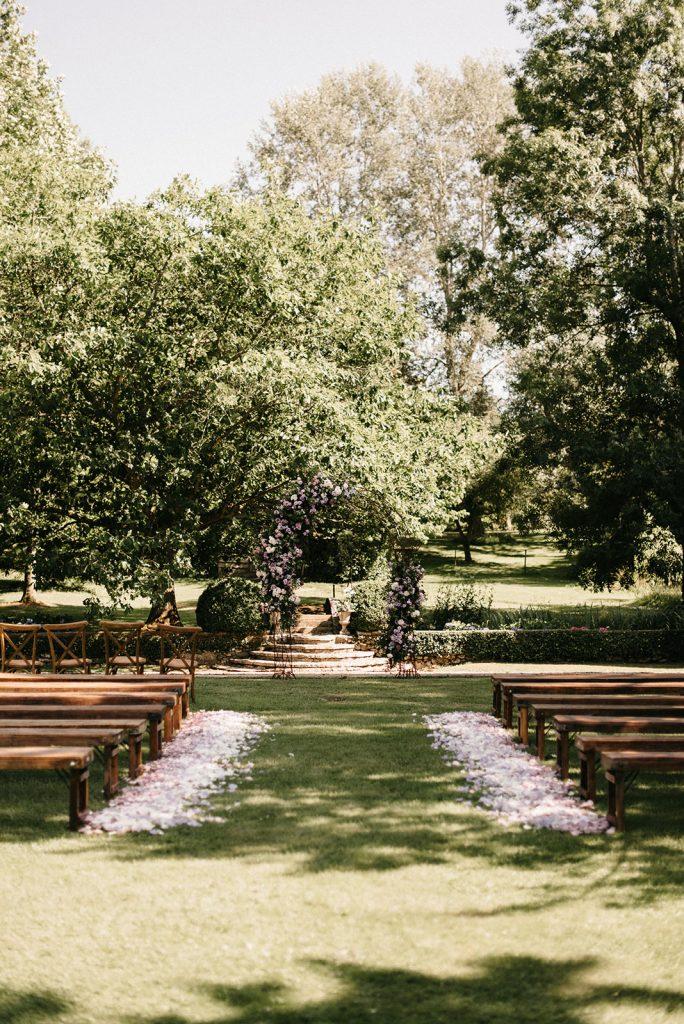 natura-outdoor-ceremony-petals-aisle-benches-lily-paloma